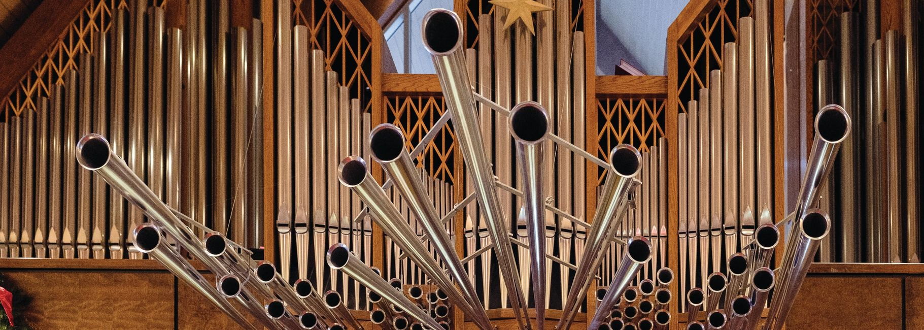 view of central organ pipes including the trumpets coming from the pipes.