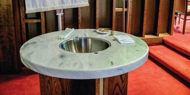A baptismal fount set-up for a baptism.