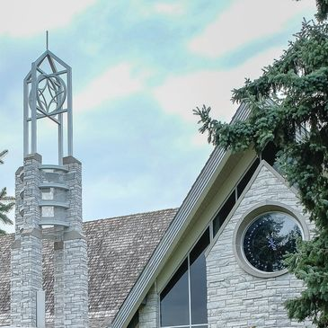 Exterior of the bell tower and chapel window.