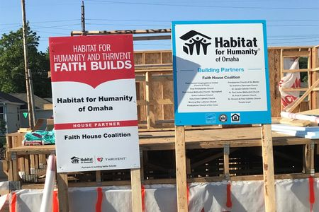 Building site with signs indicating this is sponsored by the Faith Coalition and Thrivent