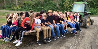 A group of youth on a hayrack ride