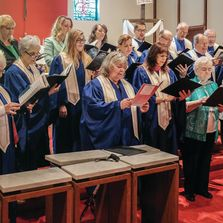 Members of the choir singing in blue robes