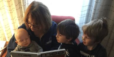 Susan reading to 3 small children