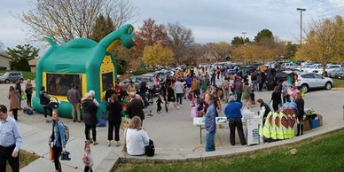 Crowd in the parking lot during the Trunk or Treat event