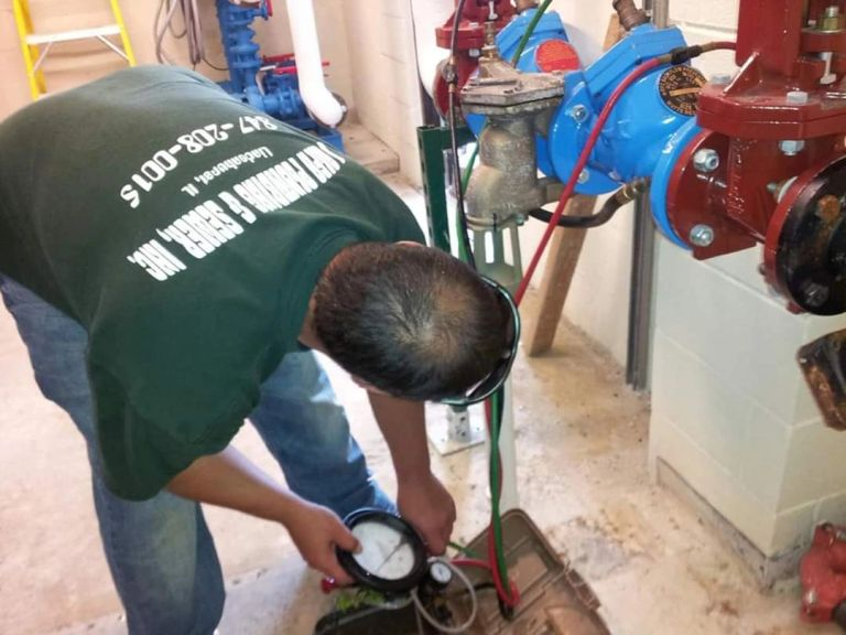 Licensed Plumber & CCCDI performing a backflow inspection/backflow test.
