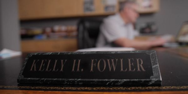 photo of attorney Kelly Fowler's nameplate on his office desk