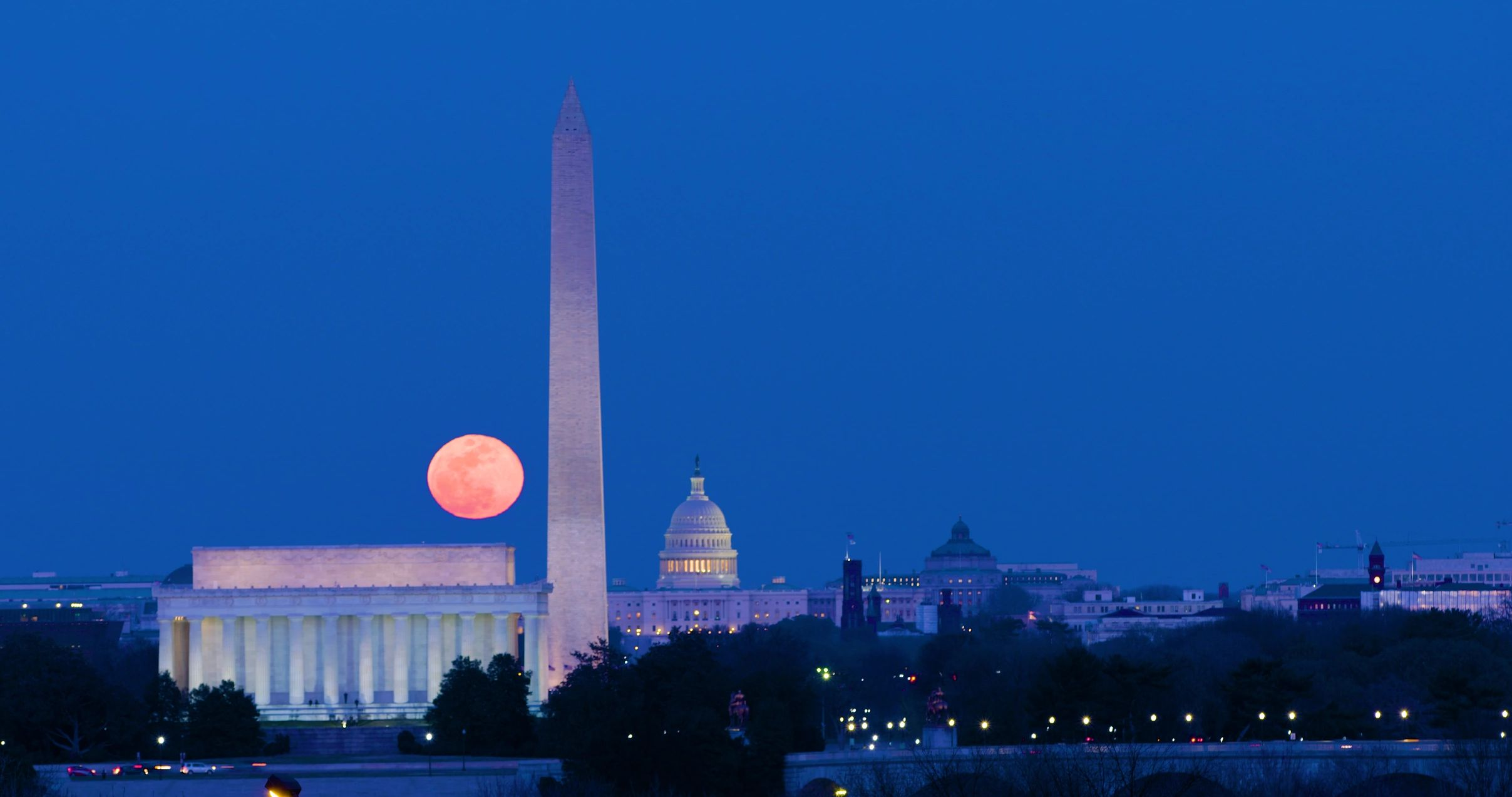 Ed Reinsel frame of 4K time lapse Moonrise over Washington DC, The US Capitol, Washington Monument.
