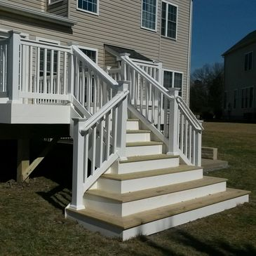 treated deck with white vinyl railing and trim