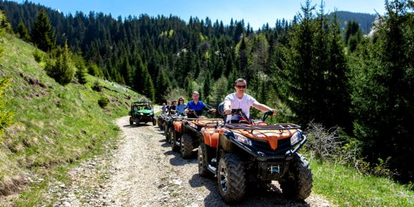 A group of riders climbing an alpine trail on their West Yellowstone ATV rentals