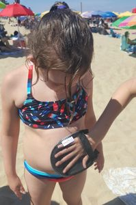 family beach vacation packing list, Sand Off beach wipe mitt, beach essentials for families,