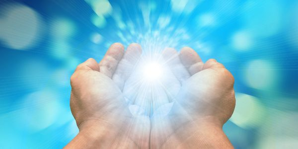 Reiki energy healing Healing Touch light in hands