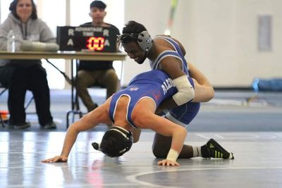 Yonas is shown above at one his wrestling matches during his freshman year at University of Dubuque.