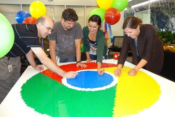 The Chrome team at Google helping to build a 5 foot version of the Chrome logo