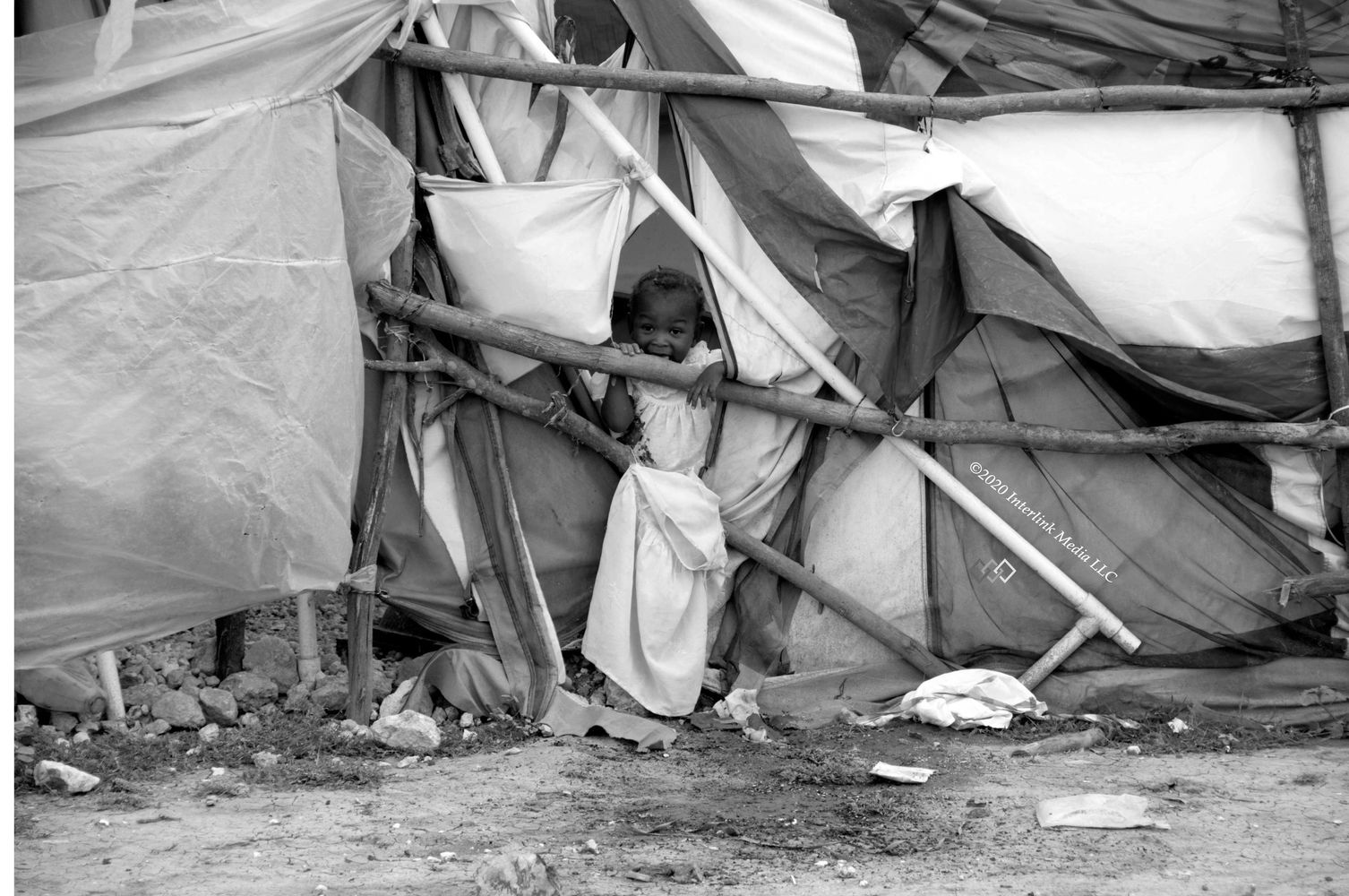 A small girl in a tent in Haiti immediately after the massive earthquake in 2010.