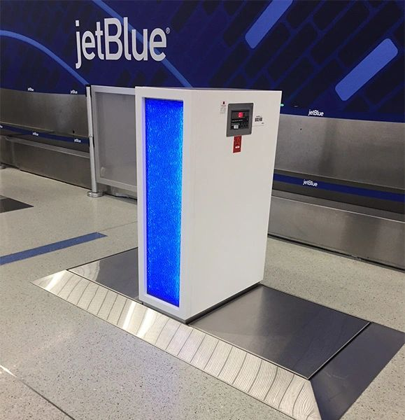Check-in stations worldwide including McCarran, Miami, JFK, and Cancún International (Mexico).