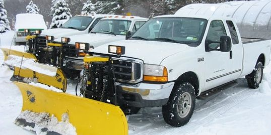 Snow plow trucks ready to plow & salt
