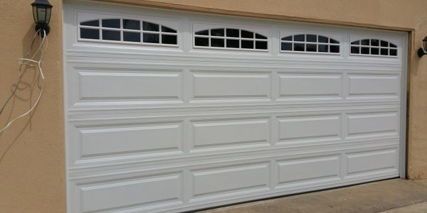 Steel garage doors by garage doors 4 less. 818-314-5545.