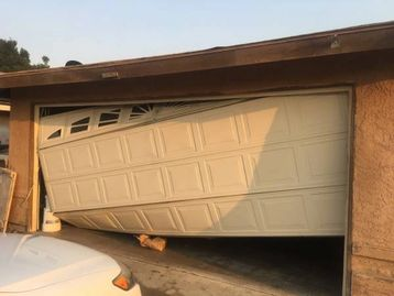 garage door off track repair by garage doors 4 less. 818-314-5545.