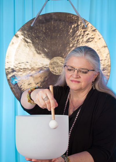 Jan Coe with gong and singing bowl