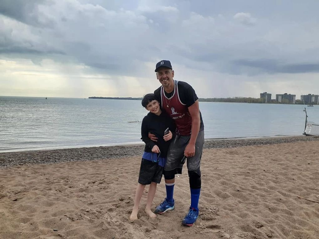 Jax and Coach Jimmy on Lake Huron coast