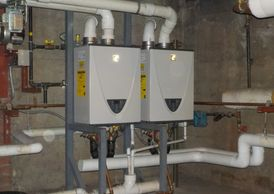 2 Tankless Water Heaters working together in a lead/lag configuration.