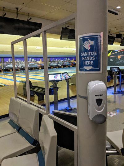 Bowling lane hand sanitizer station.