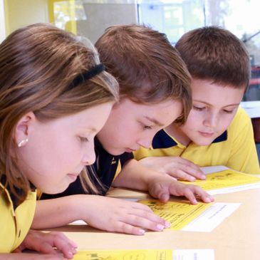 Students learning to read in a guided reading group