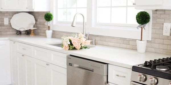 dishwasher-in-bright-kitchen-flowers-on-counter-Brooklyn-NY-Precision-Appliance