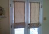 Roman shades with batons outside mounted on french doors