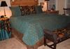 Chenille coverlet, decorative pillows and table drape