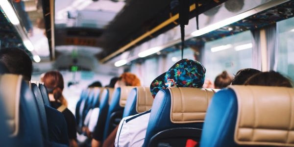 Things to do,Miami tours,Miami nightlife, metro city,metrocitytransportation,man relaxing on a bus