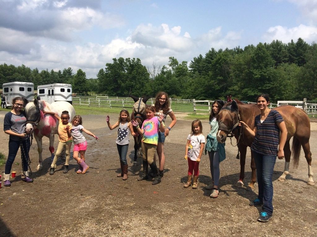 Groups of campers with their CITS and horses.