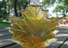 glass maple leaf filled with golden syrup