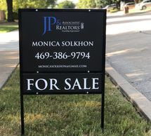 black real estate sign with main insert and rider