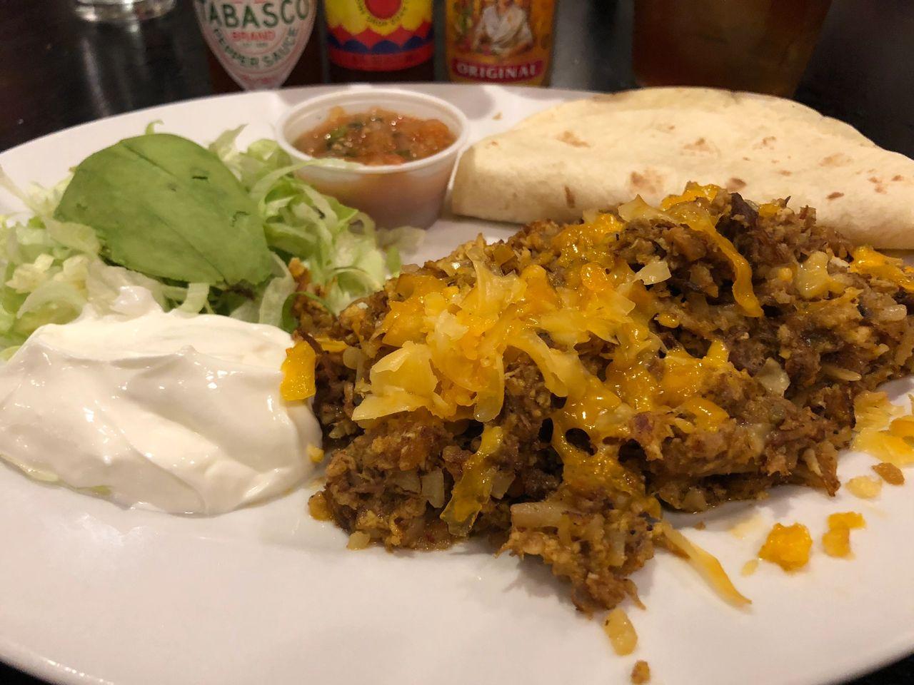 spicy pork tinga breakfast tacos at Ellen's in Dallas