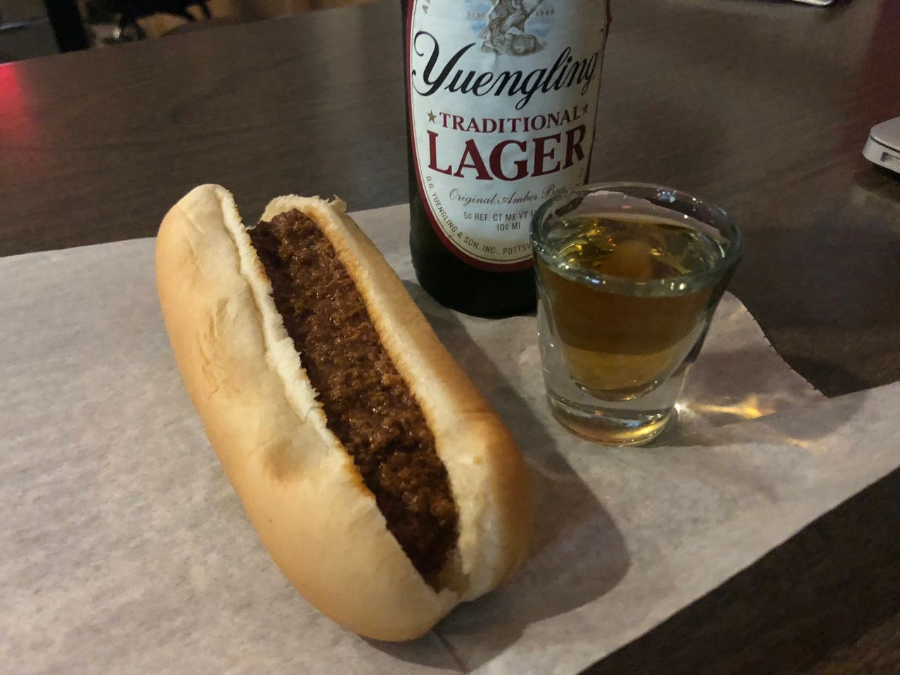 "Bottle of Yuengling, shot of Jack and hot dog ""with sauce"" at Wakim's, America's greatest dive bar."