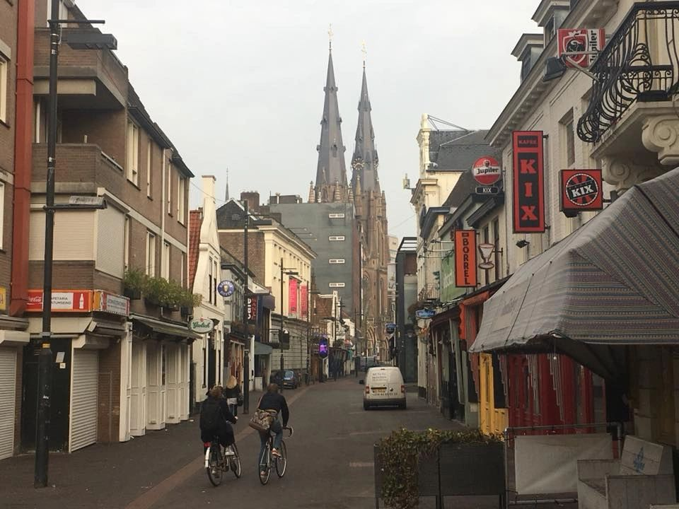 Downtown Eindhoven today, with the signature twin spires of St. Catherine's Cathedral in the background.