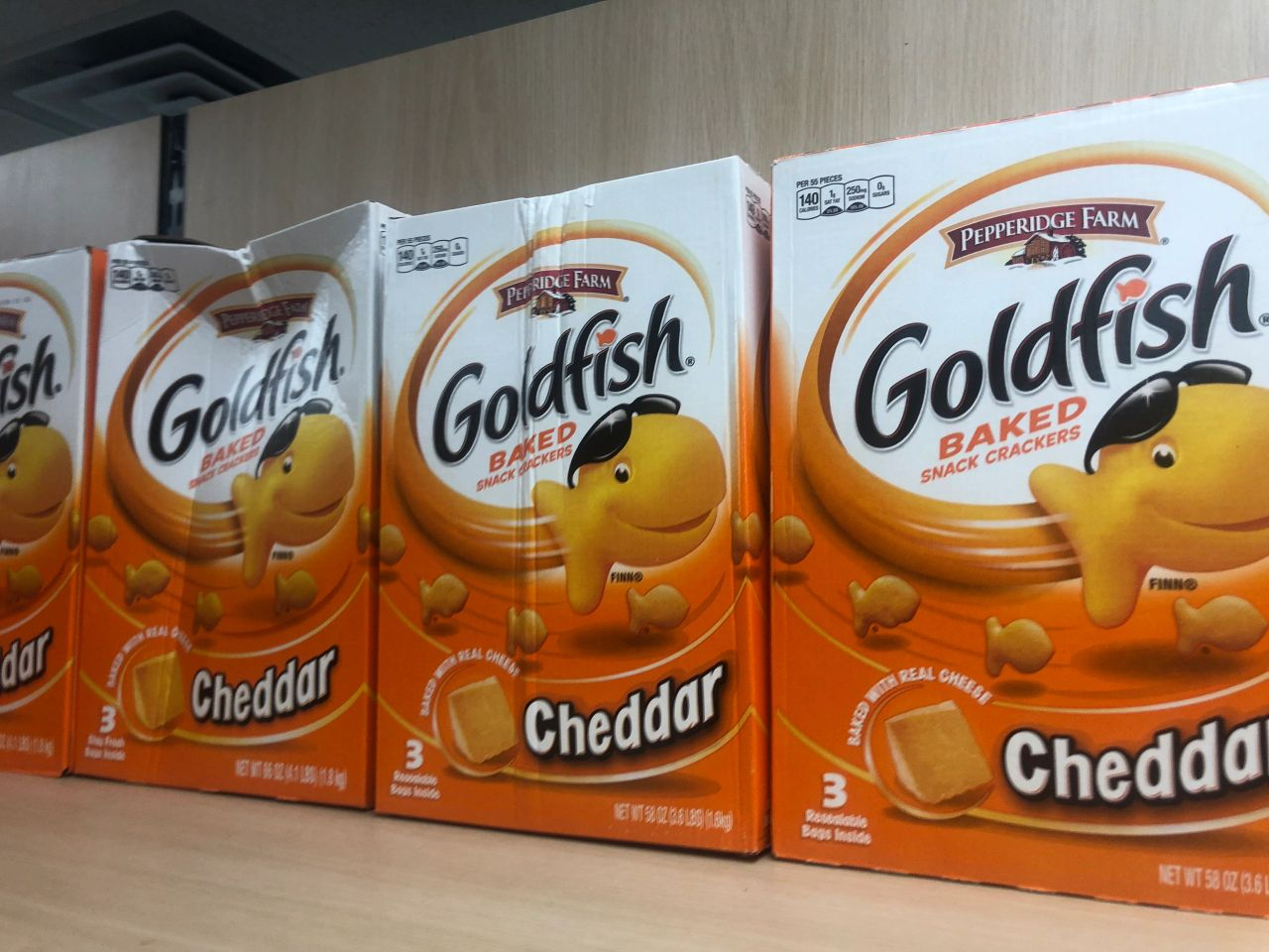 Giant 58-ounce boxes of Pepperidge Farm Goldfish, may in various states of disrepair.