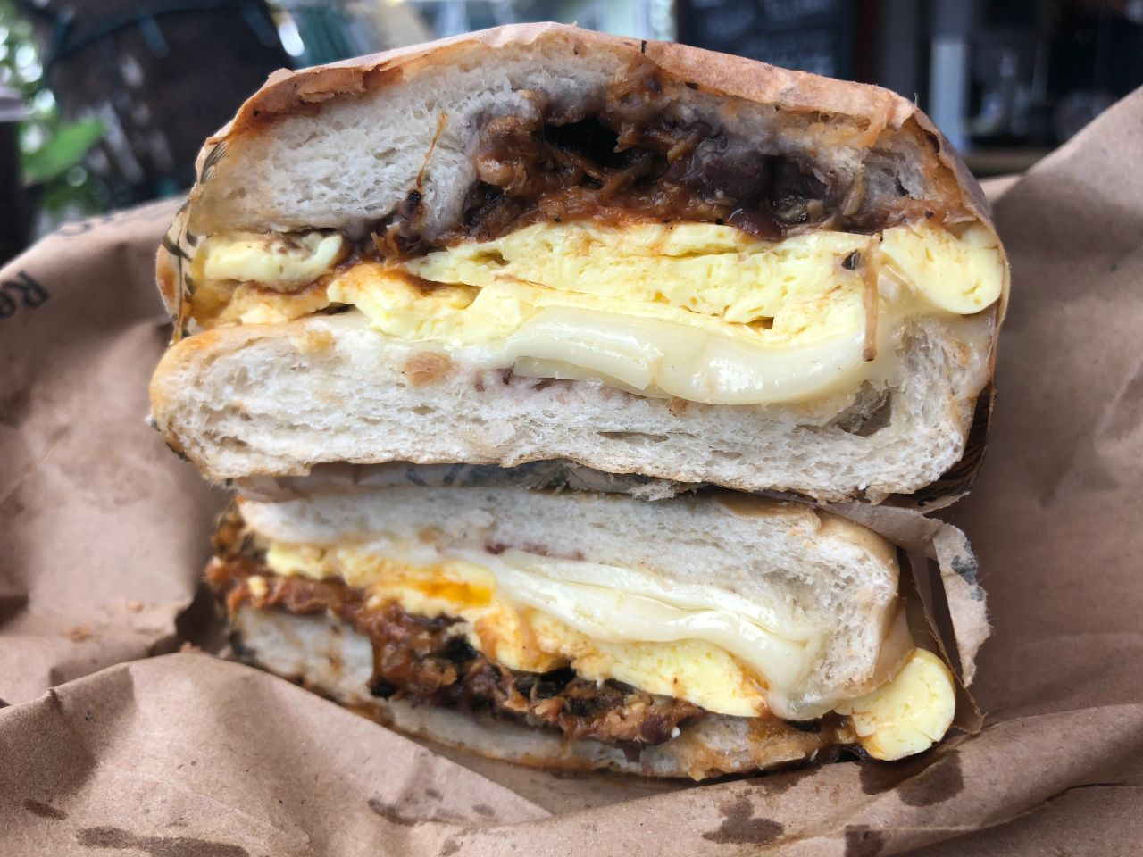 The amazing El Cubano breakfast sandwich at The Fisherman's Cafe in Key West is packed with eggs, melty Swiss cheese and three (3!) kinds of pork.
