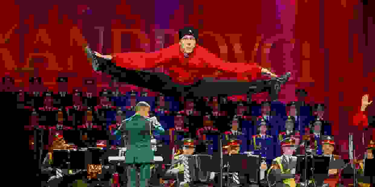 Alexandrov dancer jumpin in the air dressed as cosack