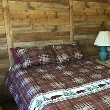Cozy cabin with queen size bed perfect for a romantic getaway or a single retreat.  Firepit.  Pond.