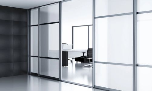Office with frosted white glass with open door entering an boardroom area