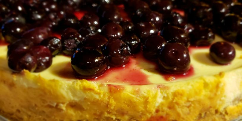 Yogurt Cheesecake with blueberries on top. close up image of the entire cake.