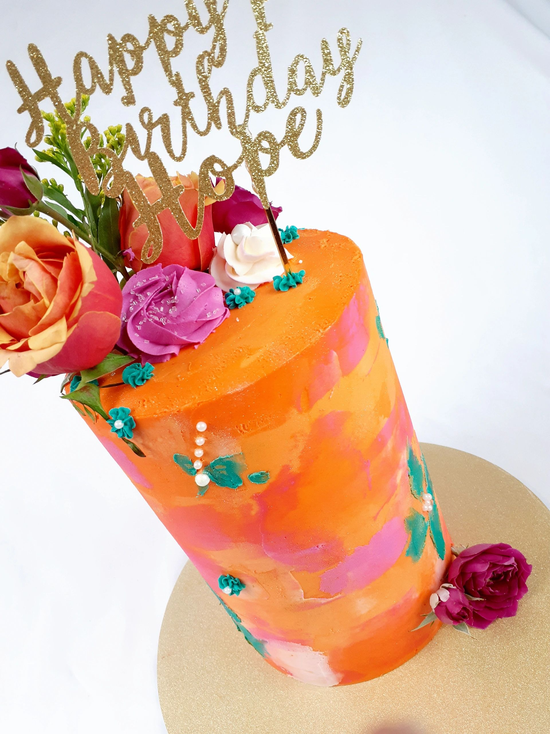 Spring Beauty is a 9in tall and 6in wide fresh beauty funfetti flavored cake with vanilla buttercrem