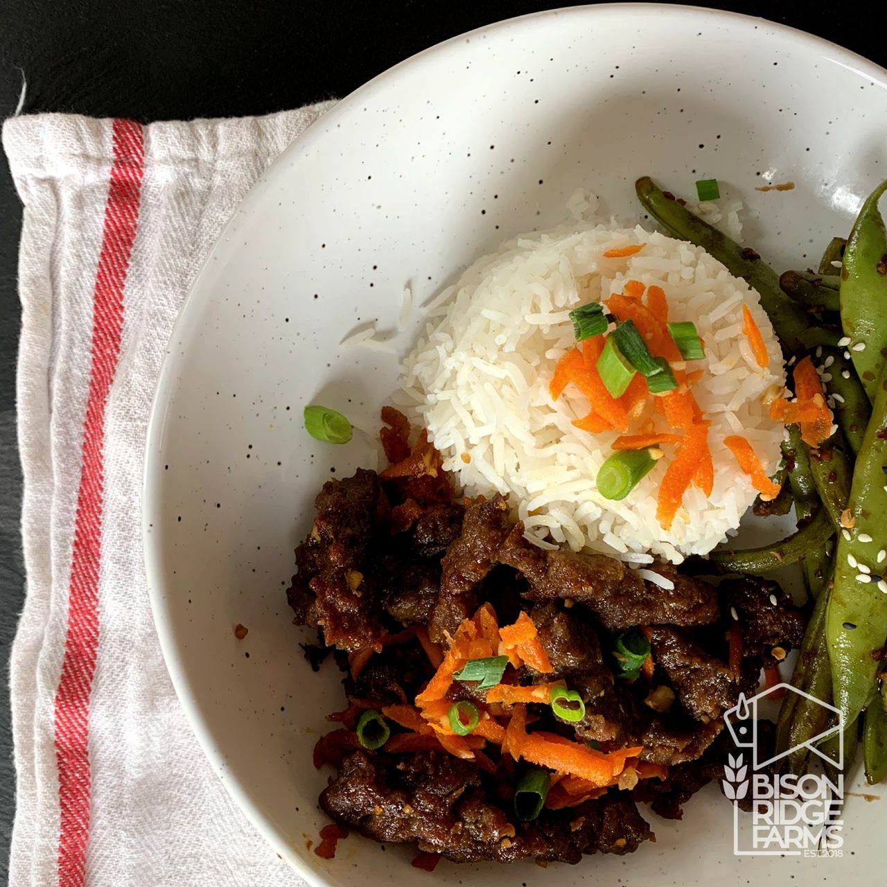 Ginger bison with rice and green beans