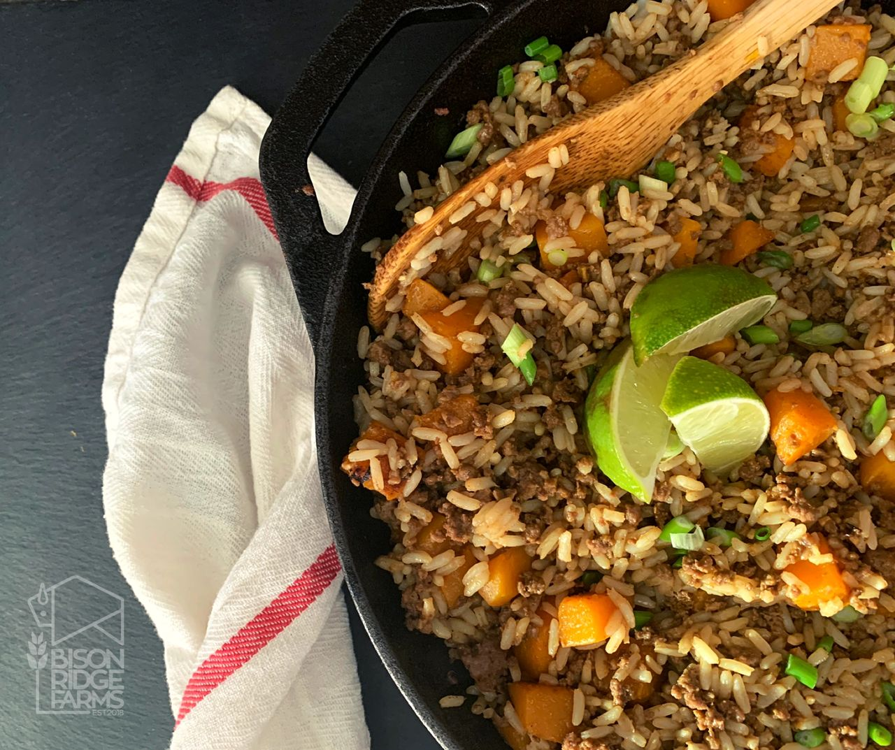 Bison and squash fried rice in a cast iron skillet