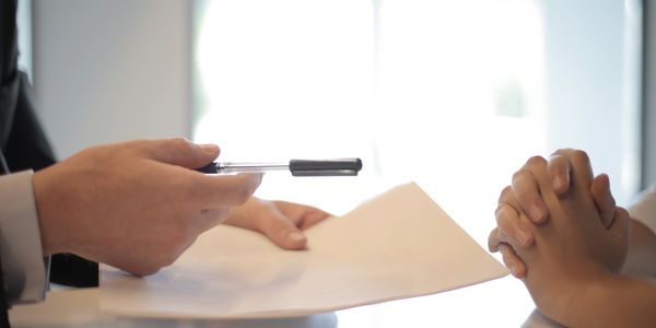 A customer signing a contract