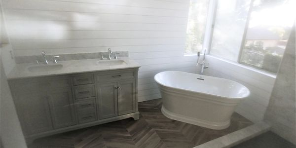 Double lav vanity & free standing tub & faucet installed in Riverside, Ca 2018.