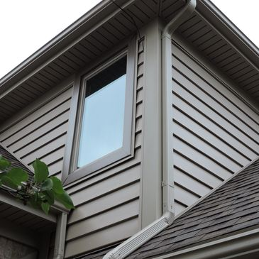 Certianteed Insulated siding, custom trim, gutters, soffit, & fascia on a lake house in Metamora, Michigan.