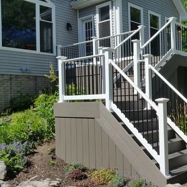 Timbertech composite decking and RDI Endurance Original Rail vinyl railing on a deck in Clio, Michigan